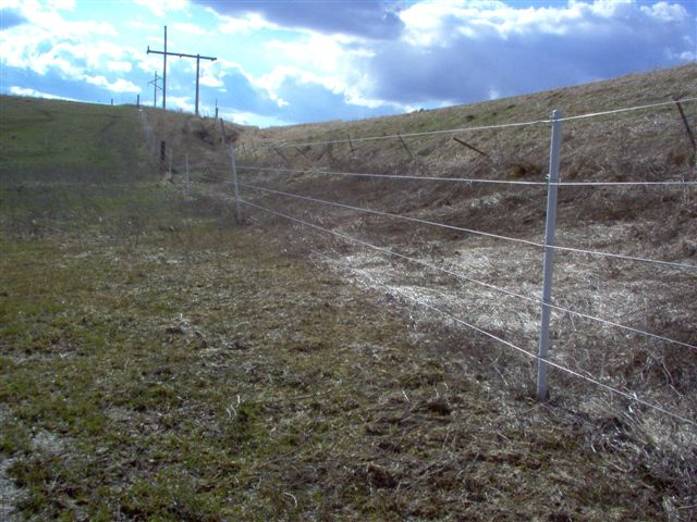 Image 8 - Spring time after melt. A side view of fence.
