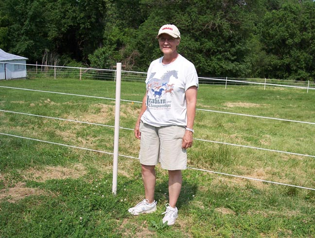 A very happy horse owner with a new fence!